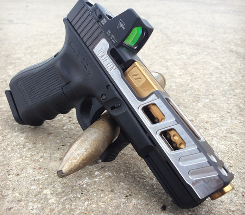 """Glock 19 with Echo Cut, Optic Cut (RMR) and Zev TiN Dimpled Barrel. Custom """"War On"""" text is not standard.Note: The Glock 17 Echo cut features slightly larger side windows."""