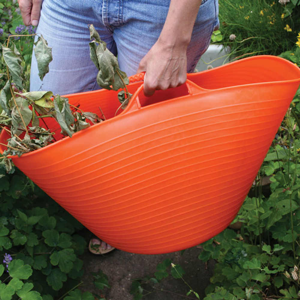 As Tubtrugs are flexible, you can squeeze together the handles to carry.