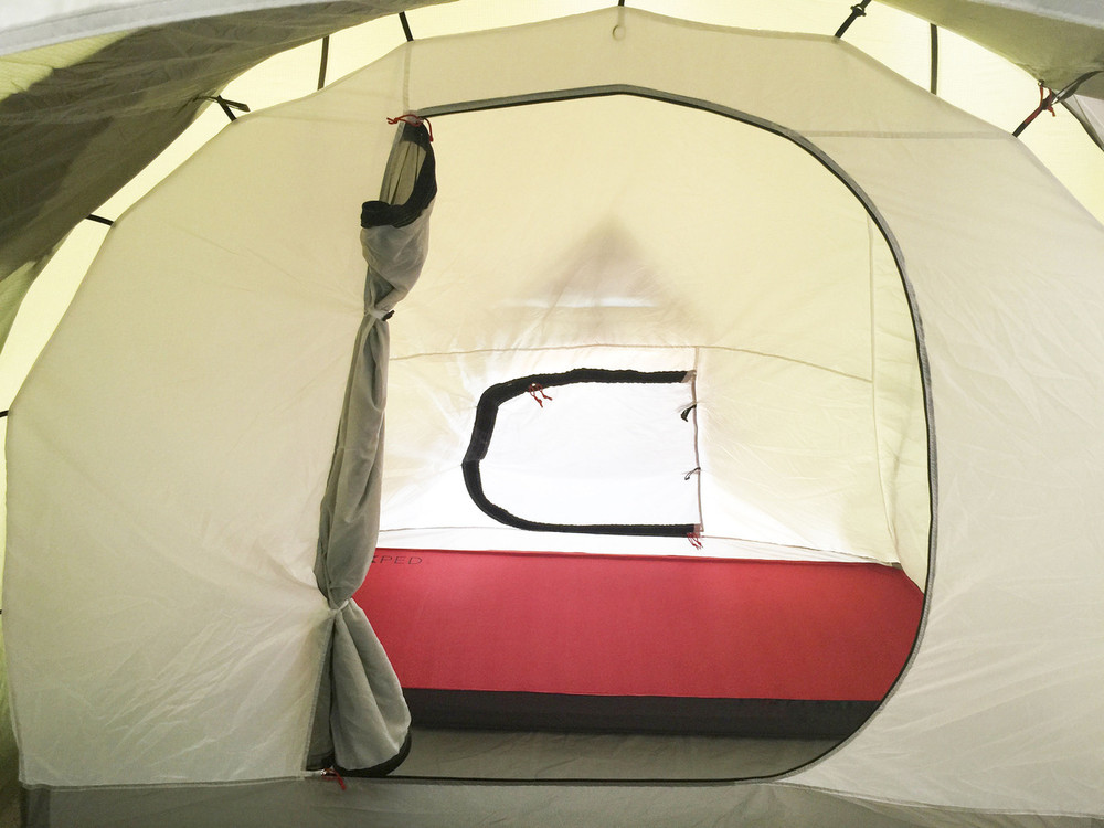 """Solo Sleeping showing 30"""" wide Megamat 10. Inner Sleeping tent has 2 entry doors from inside garage and out side tent. Both doors have privacy and mosquito screens."""