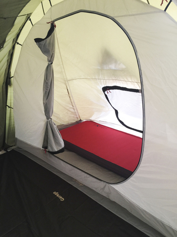 """Inner Sleeping Sleeping section is double walled, the inner hangs from the outer tent via loops and toggles. Showing a 30"""" wide Megamat 10 Sleeping Pad.  There are 2 entry doors from inside garage and out side tent. Both doors have privacy and mosquito screens."""