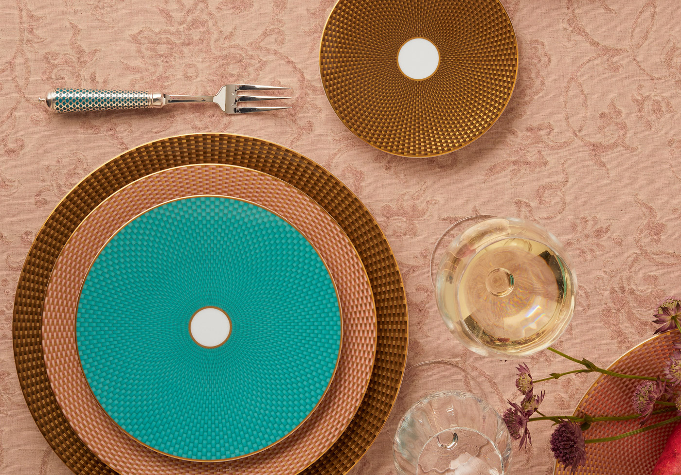Raynaud Tresor salad plate in dinner plate sitting on rose colored table linen - photo taken from birds eye perspective