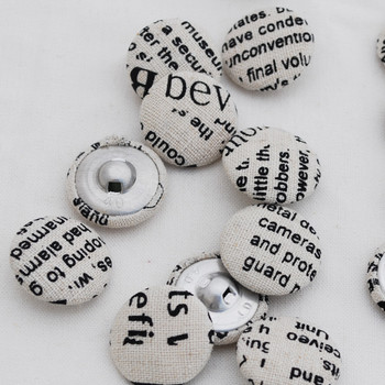 newspaper print fabric covered buttons black 25mm