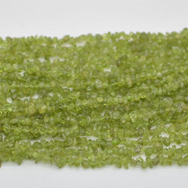 """High Quality Grade A Natural Peridot Semi-precious Gemstone Chips Nuggets Beads - 5mm - 8mm, approx 36"""" Strand"""
