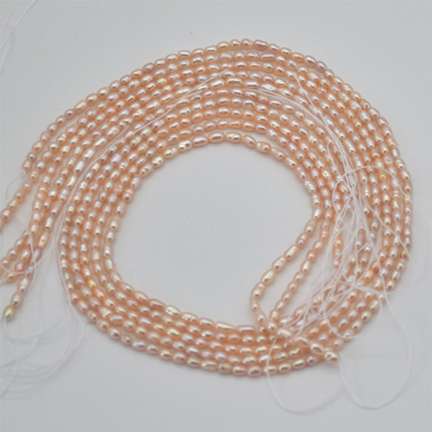 "High Quality Grade A Natural Freshwater Rice Pearl Beads - Pink Peach Orange - approx 2mm - 3mm - approx 14"" long"