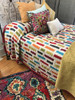 """Hand stitched Patchwork Layered Quilt Queen India  (97"""" x 106"""") Fair Trade Kantha Colors: rich Christmas red, bright turquoise, saffron, olive, washed golden olive, graphite grey and wine on a cream colored field."""