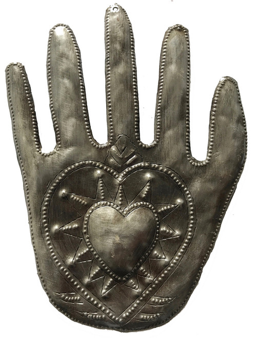 Hand hammered hand with heart design from recycled steel drum Haiti.