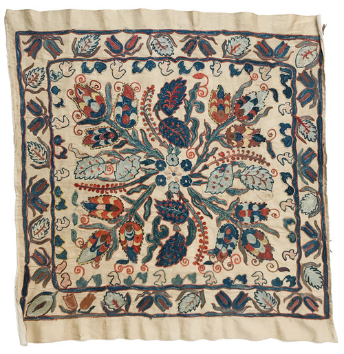 Uzbekistan mirror cover silk embroidered golden colored oatmeal satin-finish silk cloth provides the backdrop to a medley of pleasing colors including  shades of indigo, washed gold, brick, puce, robins egg blue, chalky pink, brick red.