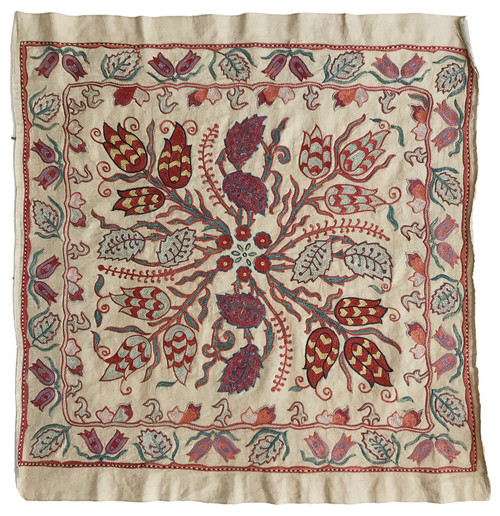Uzbekistan mirror cover silk embroidered golden colored oatmeal satin-finish silk cloth provides the backdrop  to a medley of pleasing colors including washed gold, shades of blue and green indigos, brick, dusty rose, lavender, washed papaya