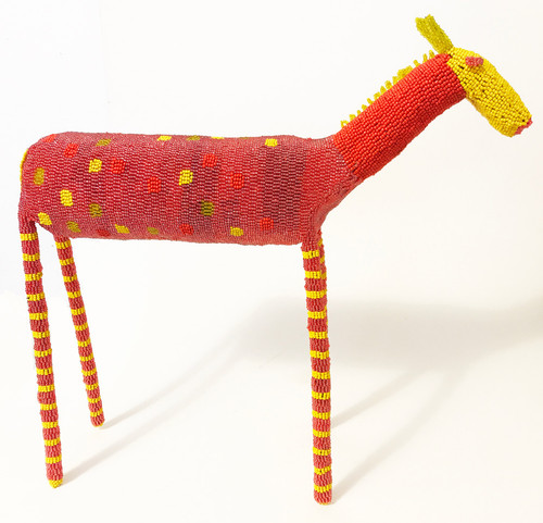 "Handmade Beaded Giraffe South Africa  (17.5"" x 17"") glassy bright rose red, glassy yellow-green, red orange, primary yellow."