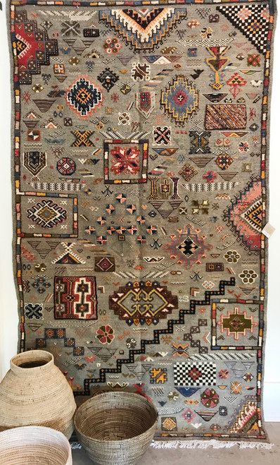 """Handwoven Ahknif Map Tapestry Wool Rug Morocco (60"""" x 102"""") A medley of colors embellish a field of handspan gray fleece. Colors include: dusty brick, dusty red, olive, black, cream, gold, navy, bear brown, dark chocolate brown, blue grey.and more."""