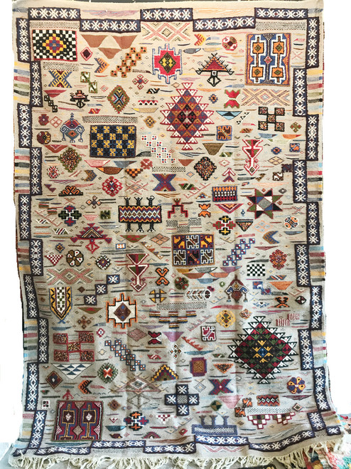 """Handwoven Ahknif Map Tapestry Wool Rug Morocco (84"""" x 119"""") A medley of colors on embellish a handspun natural gray fleece field. Colors include: mediterranean blue, red, olive, pine green, black, cream, saffron, grey, bear brown, gold."""