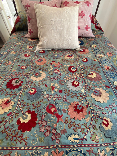 Hand Embroidered Silk Suzani Coverlet Uzbekistan Colors on a icy blue ground include: rich red, vibrant indigo, off white, puce, robins egg blue, washed and chalky green, dusty rose, washed ecru.