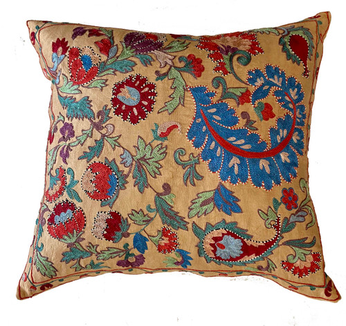 """Hand Embroidered Silk Pillow Uzbekistan (19"""" x 19"""") washed soft wheat color. Embroidery colors: washed pine, chalky turquoise, medium indigo, pale green, washed red brown, burgundy, brick red, deep violet and more."""