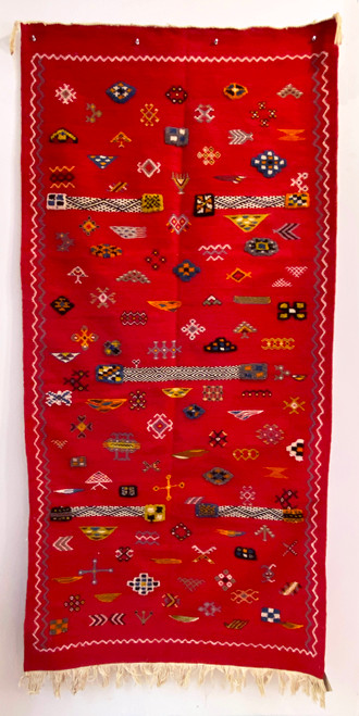 """Handwoven Ahknif  Tapestry Red Wool Rug  Morocco (37"""" x 76"""") Red field with design elements in ochre, pumpkin, light olive, black, natural white, medium indigo, grey, moss green."""