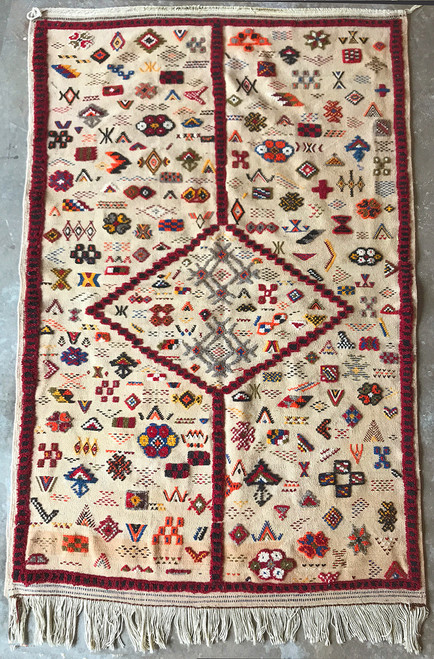 """Handwoven Ahknif Tapestry Wool Rug  Morocco (42"""" x 65"""")  flat weave, knotted pile, embroidery all wool. A medley of colors on a light camel colored field including rich red, black, medium gray, Mediterranean  blue, hunter orange, olive, gold, cream."""