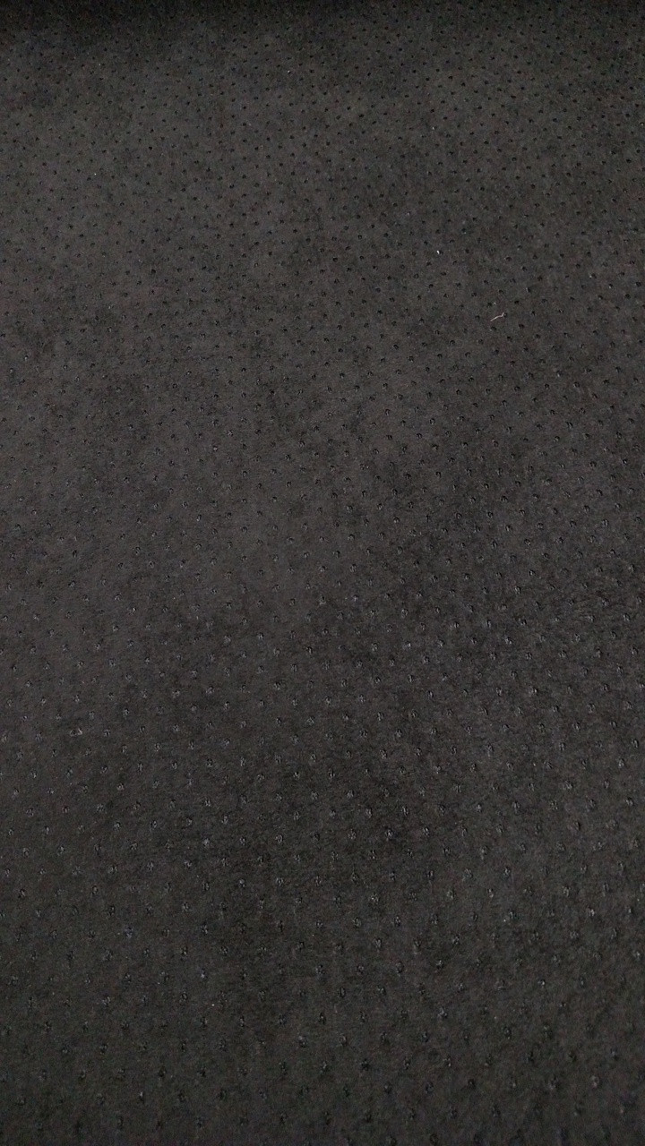 """Synergy LAZOR PERFORATED Onyx Suede (Black) 54"""" Sold by the CONTINUOUS YARD"""