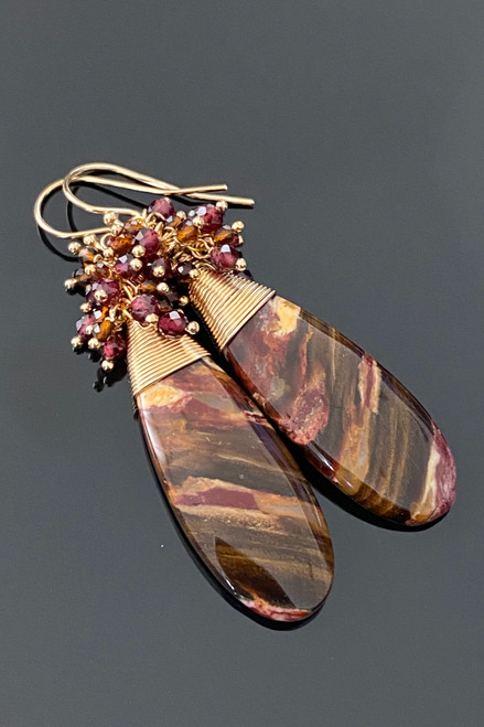 Earth toned Australian Fossilized Wood with Garnets and Whiskey Quartz.