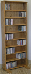 """DVD shelves 60"""" high shown in light brown oak. 8 adjustable shelves. wall mountable.Feet can be removed. All formaldehyde free cabinet plywood construction. No particle board. A real quality cabinet. decibeldesigns.com 888.850.5589"""