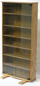 "DVD storage cabinet 48""H shown in Minwax Golden Oak with gray glass doors. decibeldesigns.com 888.850.5589"