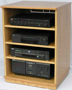 Tv stand 33 inches high with three adjustable shelves. Shown in light brown oak finish. http://www.decibeldesigns.com 888.850.5589