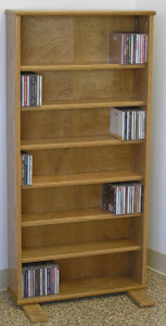 "DVD storage cabinet 48""H shown in Light Brown Oak."