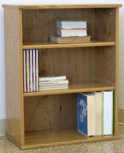 "Bookcase 31""H with two adjustable shelves. Glass doors available. Stores hardbound books, LP's, and lazer discs. 23"" wide all formaldehyde free plywood construction. Available in Oak or Maple unfinished or with standard or custom finishes.Simple assembly. Matching CD DVD cabinets and stereo cabinets. We're here to create quality for you! decibeldesigns.com 888.850.5589"