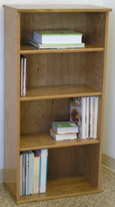 "Wall shelves 49 inches high with three adjustable shelves. Shown in light brown oak finish. Glass doors available. Stores hardbound books, LP's, and lazer discs. 23"" wide all formaldehyde free plywood construction. Available in Oak or Maple unfinished or with standard or custom finishes.Simple assembly. Matching CD DVD cabinets and stereo cabinets. We're here to create quality for you!  http://www.decibeldesigns.com  telephone 888.850.5589"