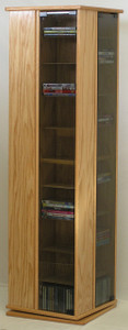 Swivel DVD rack with gray tempered glass doors 60 inches high. 17 x 17 inch base. 36 adjustable shelves. Formaldehyde free cabinet plywood.  888.850.5589 decibeldesigns.com