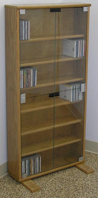 "DVD storage cabinet 48""H shown in Light Brown Oak with clear glass doors. decibeldesigns.com 888.850.5589"