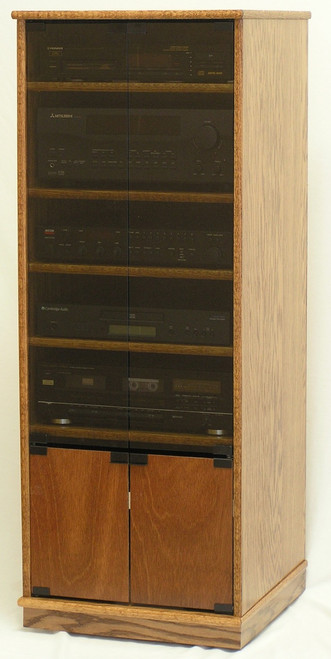 "Narrow Stereo Cabinet 53""H  shown in  Minwax Early American custom stain with gray glass doors and bottom wood doors..  http://www.decibeldesigns.com  telephone 888.850.5589"