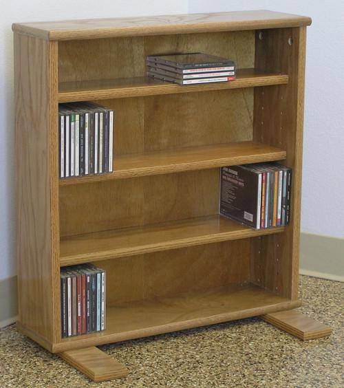 DVD cabinet 25 inches high shown in light brown oak finish. 3 adjustable shelves. decibeldesigns.com 888.850.5589