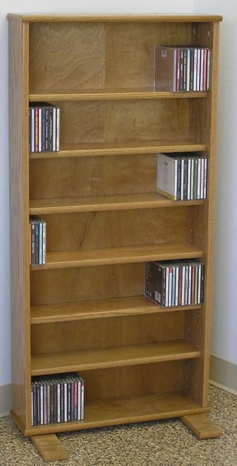 "DVD storage cabinet 48""H shown in Light Brown Oak."