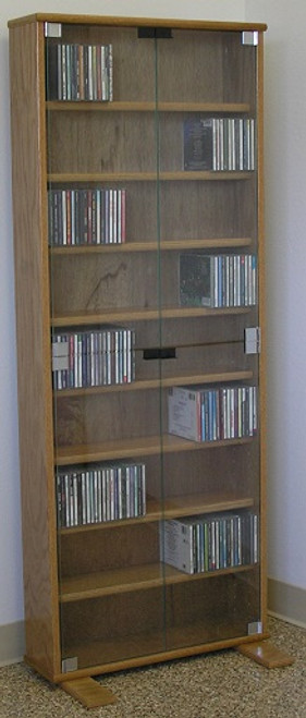 "DVD shelves 60"" high with clear glass doors shown in light brown oak. decibeldesigns.com 888.850.5589"