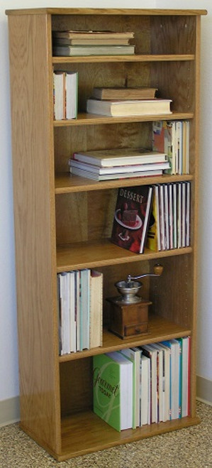"Bookcase shelving 60""H with five adjustable shelves.  Shown in light brown oak finish. Glass doors available. Stores hardbound books, LP's, and lazer discs. 23"" wide all formaldehyde free plywood construction. Available in Oak or Maple unfinished or with standard or custom finishes.Simple assembly. Matching CD DVD cabinets and stereo cabinets. We're here to create quality for you! decibeldesigns.com 805.331.8506"