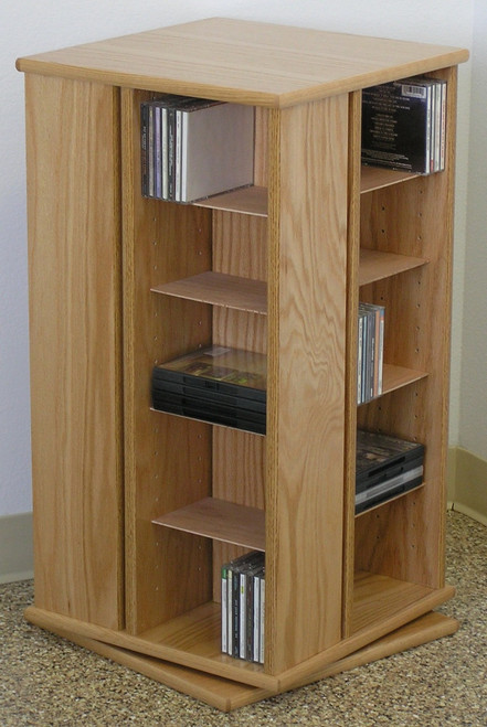 Swivel DVD storage cabinet 30 inches high shown in natural oak finish.