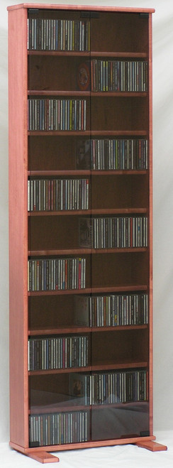 DVD rack 72 inches high with gray tempered glass doors. 10 adjustable shelves. Shown in Maple with Minwax Sedona Red finish 888.850.5589 decibeldesigns.com