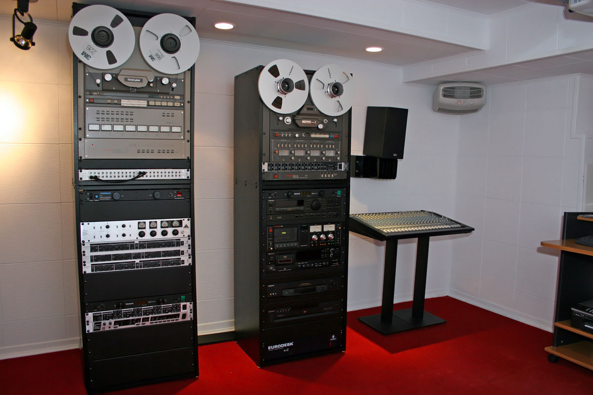 Simple black reel to reel cabinets about 6 feet tall.