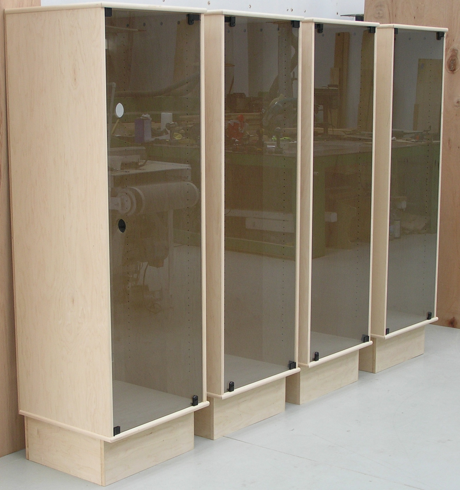 A group of 4 SC2272 maple with a single glass door with locks by decibeldesigns.com