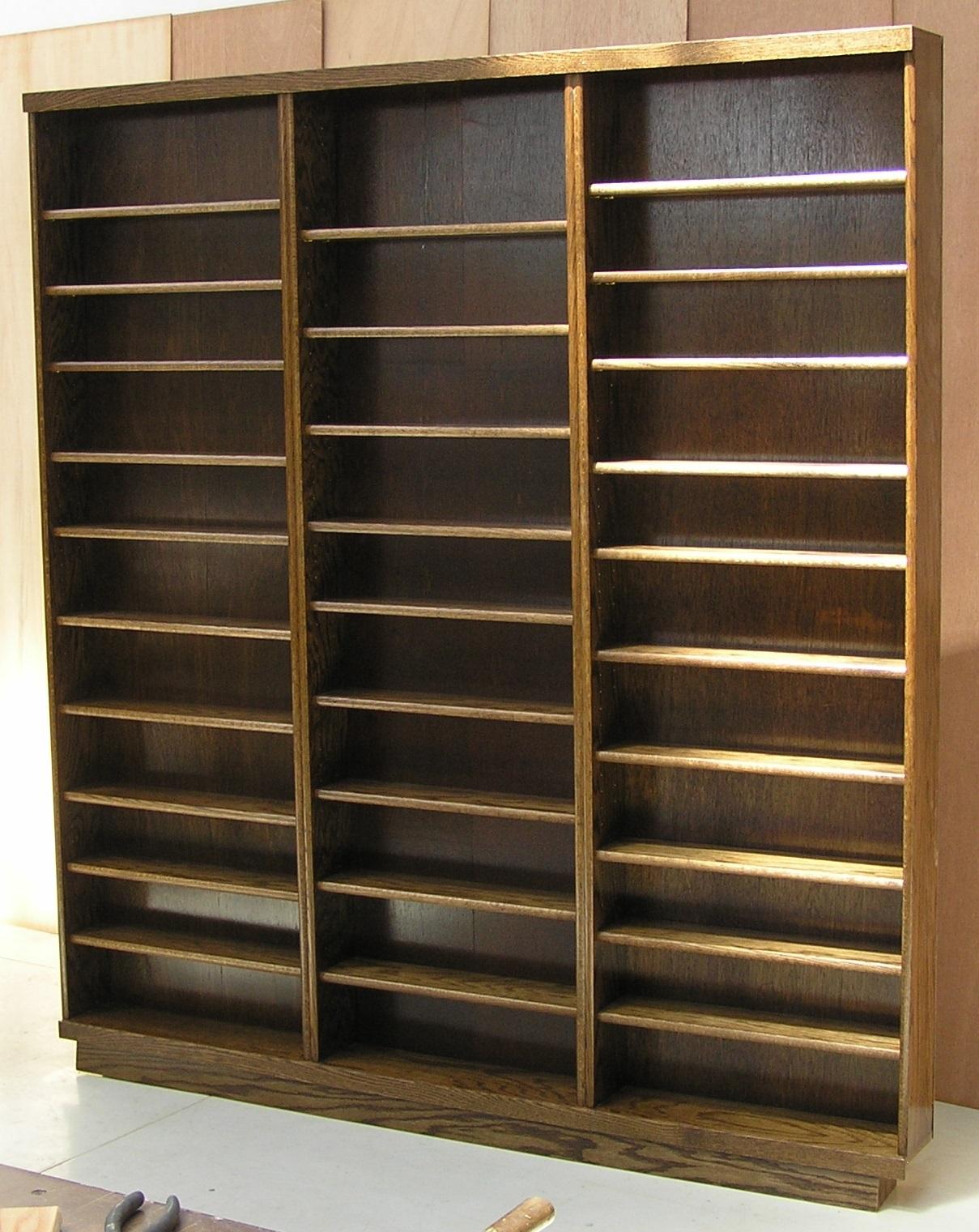 dark-walnut-triple-dvd-cabinet.jpg by decibeldesigns.com adjustable shelves