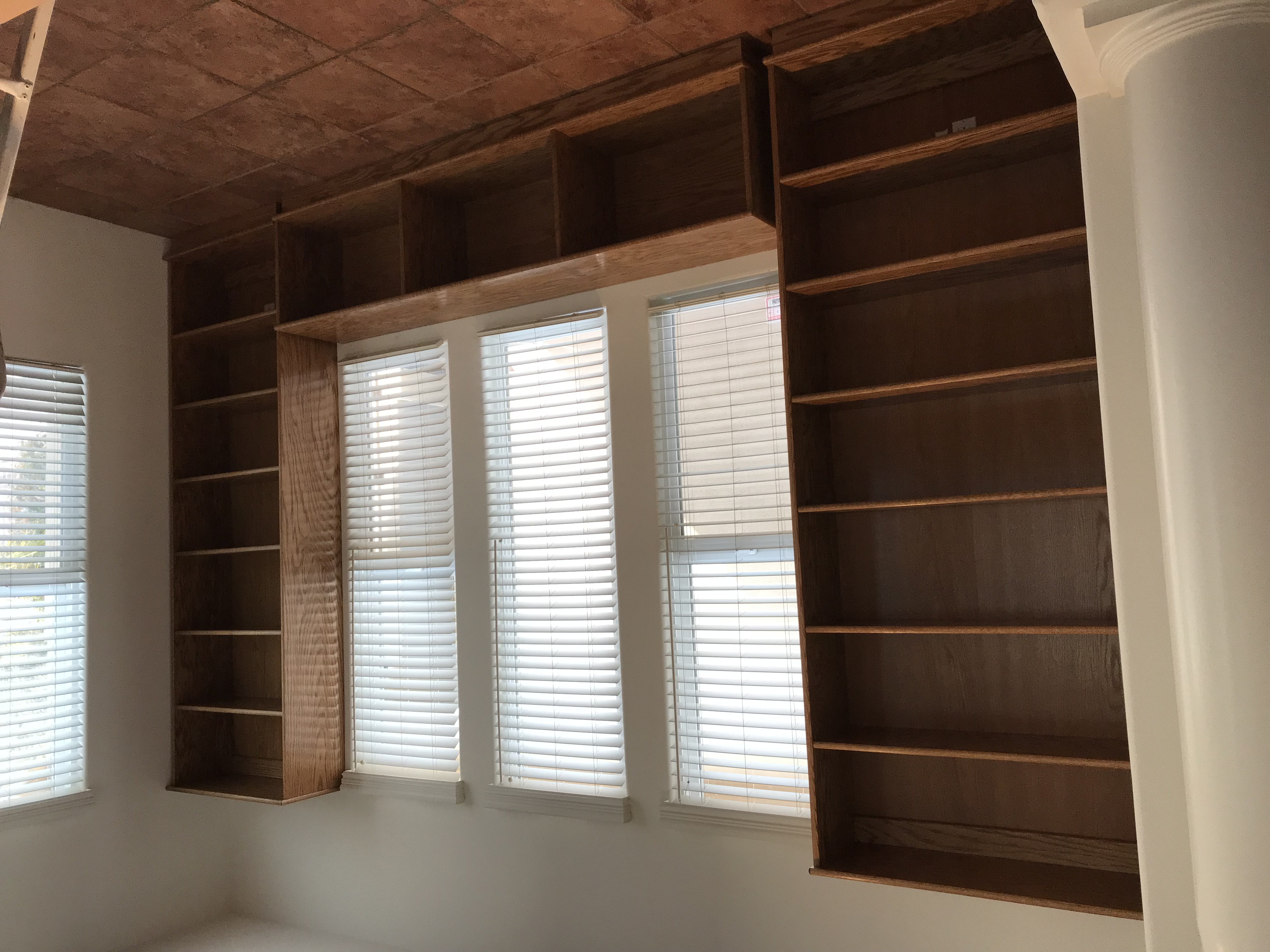 Eight foot high bookcases and LP lowboy in Minwax Golden Oak stain.