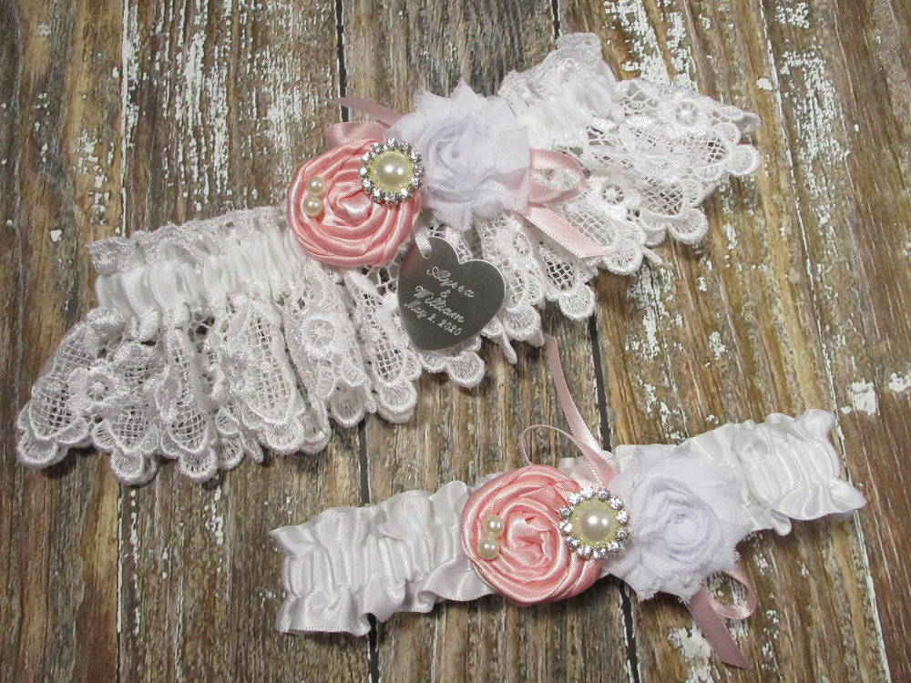 Personalized White Lace Wedding Garter Set Shown with Pink Roses