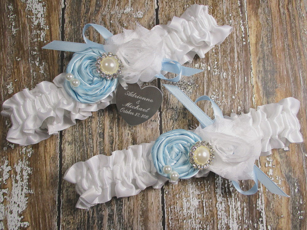 Personalized White Satin Wedding Garter Set Shown with Light Blue Roses and Bows
