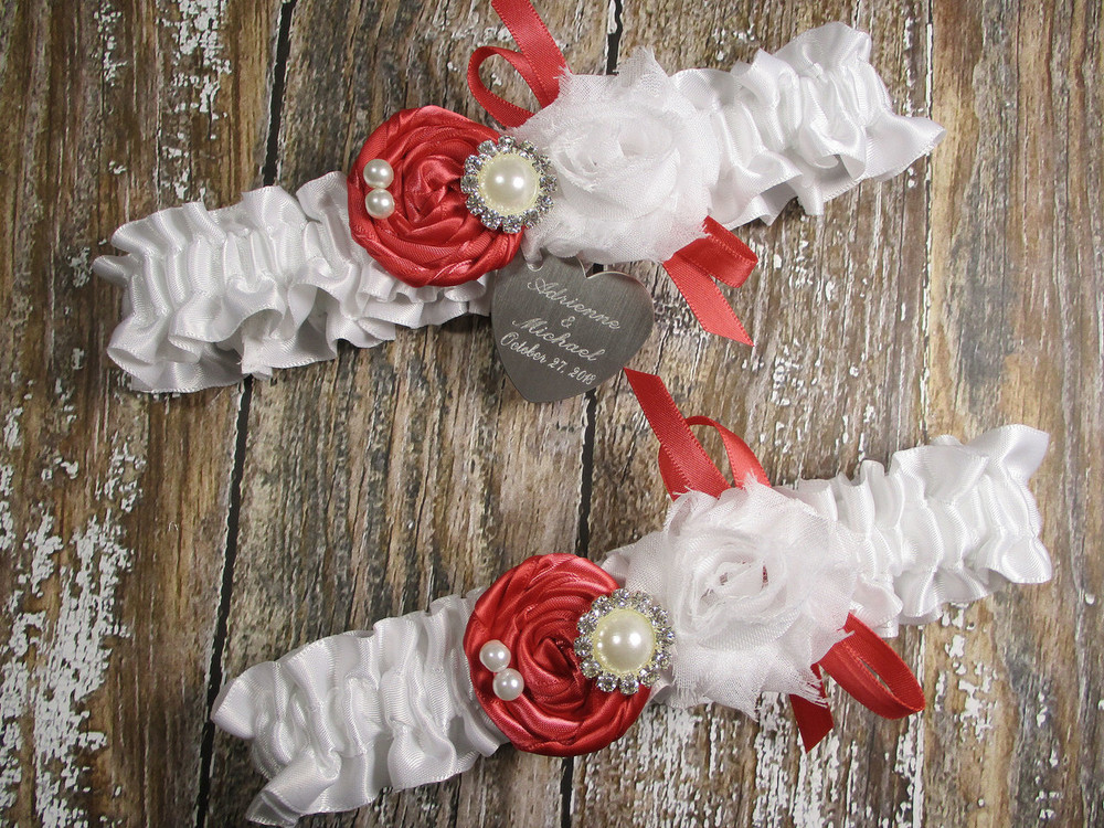 Personalized White Satin Wedding Garter Set Shown with Coral Roses and Bows