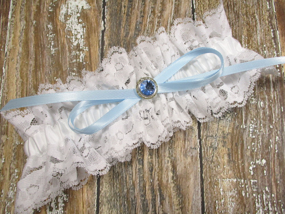 The Beautiful Ivory White Wedding Garter with a Blue Crystal
