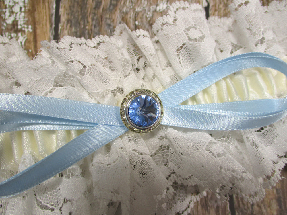 Details of the Blue Crystal on the Ivory Lace Wedding Garter