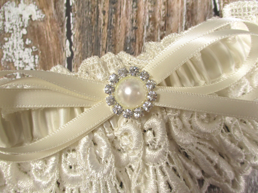 Details of the Ivory Lace Wedding Garter with Pearls and Rhinestones
