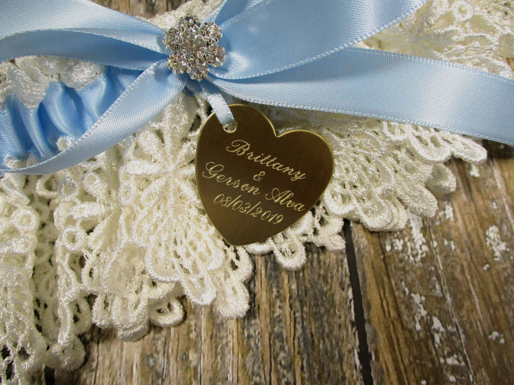 Details of the Engraving on the Personalized Ivory and Blue Wedding Garter