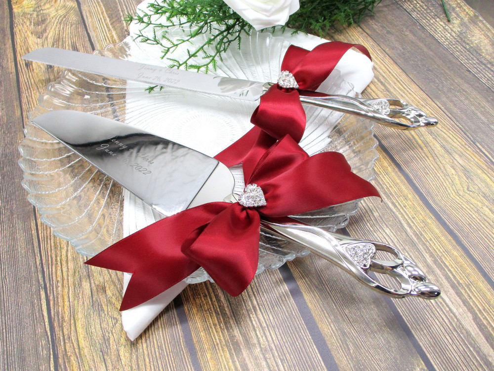 Engraved Embrace Cake Serving Set Shown with Scarlet Red Bows