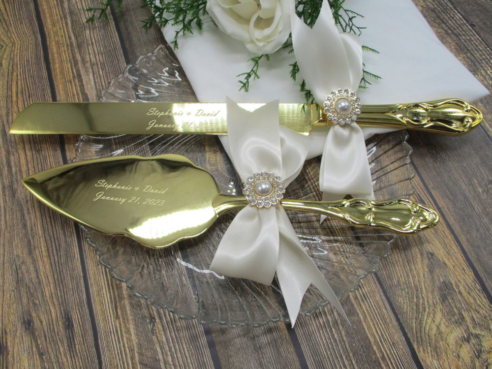 Engraved Gold Wedding Cake Serving Set Shown with Ivory Satin Bows