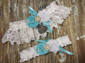 Personalized White Lace Wedding Garter Set Shown with Robin's Egg Blue Roses